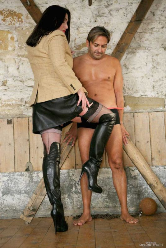 Miss Hybrid huge tits, hard nipples and leather skirt and boots.