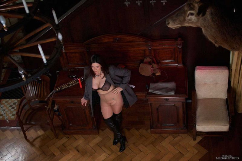 Miss Hybrid huge tits and hard nipples, leather thigh boots and pantyhose.